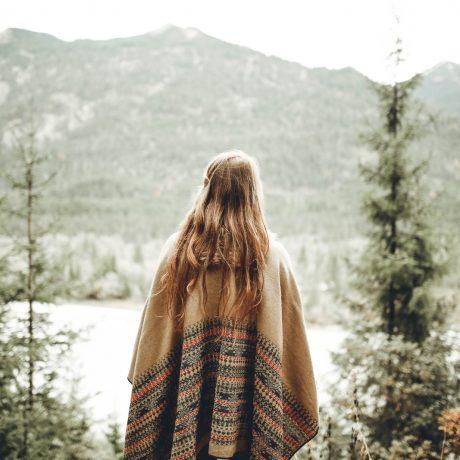 Canva - Woman Wearing Brown Poncho Facing Mountain